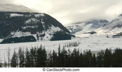 Aerial View of Beautiful Canadian Nature Landscape. Snow Covered in Winter. Located near Pemberton, British Columbia, Canada.