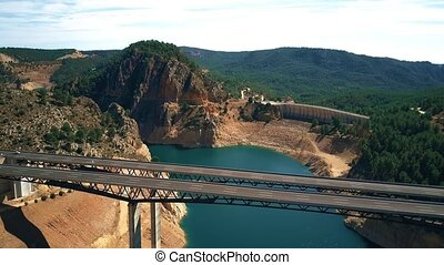 Aerial view of beautiful highway viaduct and dam in highland...