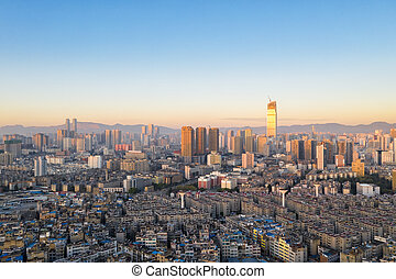 kunming cityscape in early morning - aerial view of ...