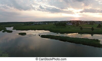 Aerial view of beautiful lake at evening