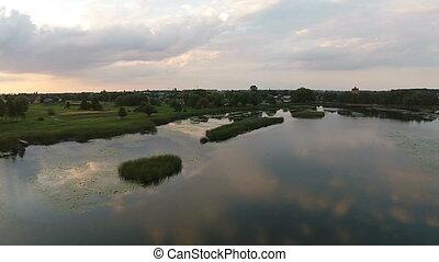 Aerial view of beautiful lake at sunset