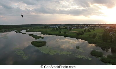 Aerial view of beautiful lake at sunset