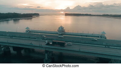 Aerial view of beautiful sea and bridge during sunset