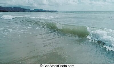 Aerial view of beautiful sea waves near the beach