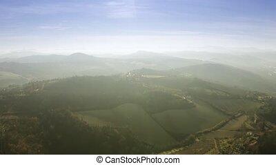 Aerial view of beautiful sunlit hilly landscape of Emilia-Romagna region