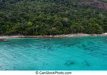 Aerial view of beautiful tropical beach with crystal clear lagoon sea