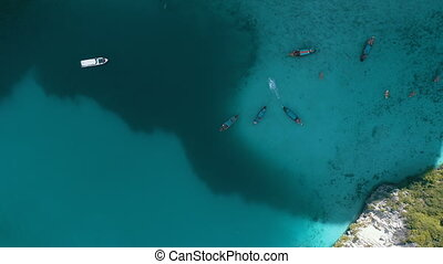 Aerial view of beautiful tropical turquoise water with boats