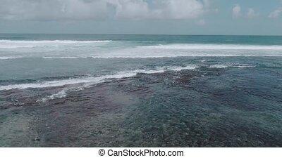 Aerial view of beautiful waves against sky