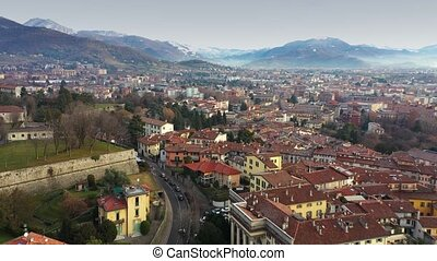 Aerial view of Bergamo cityscape and surrounding mountains,...