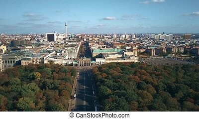Aerial view of Berlin involving famous Brandenburg Gate and TV tower