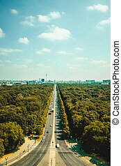 Aerial view of Berlin skyline panorama on a sunny day with blue sky and clouds in summer seen from Victory Column Siegessaeule, Germany