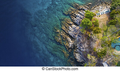 aerial view of beuatiful blue ocean and rock coastal in phuket southern of thailand
