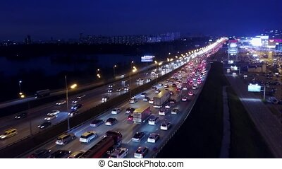 Aerial view of big city highway traffic jam in the evening...