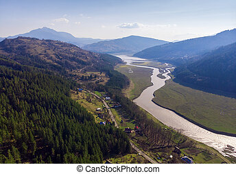 aerial view of Bistrita river and Ceahlau mountain, Romania