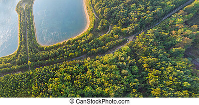 Aerial view of blue lakes and green forests on a sunny day in drone photography