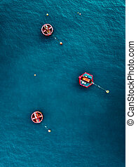 Aerial view of Blue Sea surface with buoys