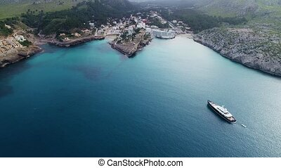 aerial view of boat at seashore - drone view of boat in blue...