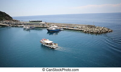 Aerial view of boat enters in port