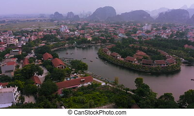 Aerial view of boat tours travelling from Tam Coc to see the beautiful landscape