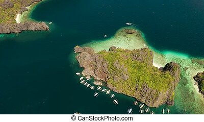 aerial view of boats and limestone cliffs. El nido,...
