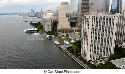 Aerial view of boats docked at the North Cove Marina, Hudson River at Battery Park in Manhattan with Brookfield Place Complex and offices buildings on the background. New York, USA. April 10th, 2019