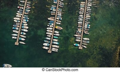 Aerial view of boats docked in port - Top view of yachts...