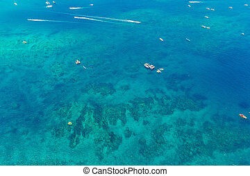 Aerial view of boats in the tropical sea