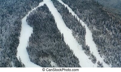 Aerial view of Borsec ski slope with frozen forest in...