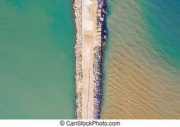 aerial view of breakwater in a small harbor