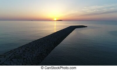 aerial view of breakwater of stone in the sea - aerial view...