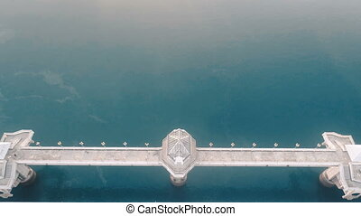 Aerial view of bridge and sea with visible oil leak - Aerial...