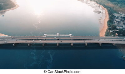 Aerial view of bridge and sea with visible oil leak