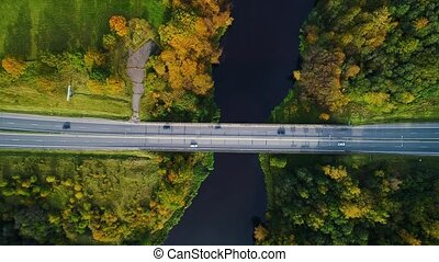 aerial view of bridge over river - aerial view of cars on...