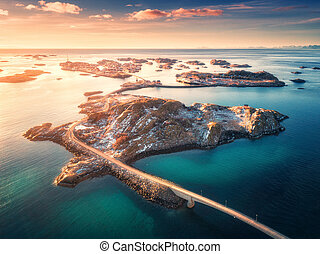 Aerial view of bridge over the sea and mountains in Norway
