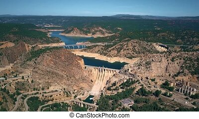 Aerial view of bridges and dam in mountainous area of Spain...