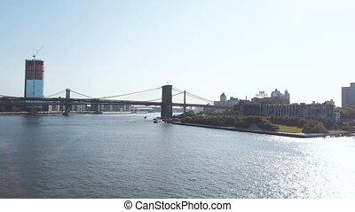 Aerial view of Brooklyn bridge through East river in New...