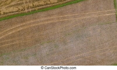 Aerial view of brown and green fields - A dolly, aerial view...