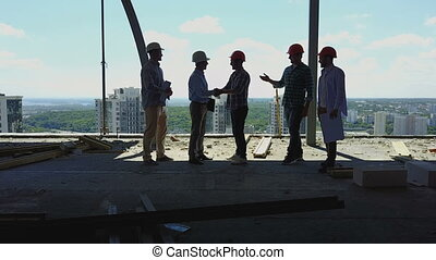 Aerial View Of Builders Team Handshake With Business Man...