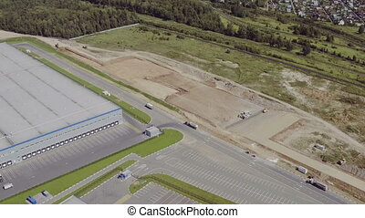 Aerial view of building a new warehouse - Flying around a...