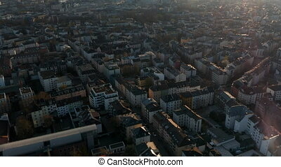Aerial view of buildings and streets of Bornheim neighbourhood. Tilt up revealing skyline with group of skyscrapers downtown. Frankfurt am Main, Germany. 4K.