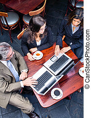 aerial view of business meeting - an aerial view of three co...