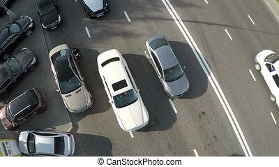 Aerial view of cameraman shooting driving cars - Aerial shot...
