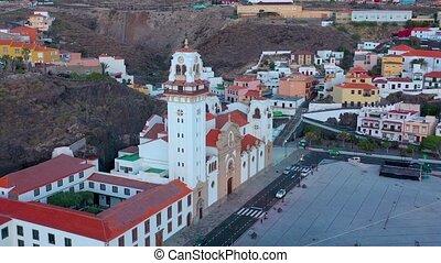 Aerial View of Candelaria - City, coast and Basilica near the capital of the island - Santa Cruz de Tenerife on the Atlantic coast at sunrise. Tenerife, Canary Islands, Spain.