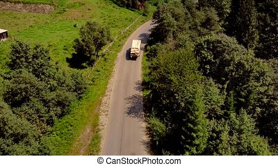 Aerial view of car on road in mountains.