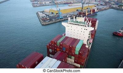 Aerial view of cargo ship docking