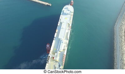 Aerial view of cargo ship entering the port in Bar city