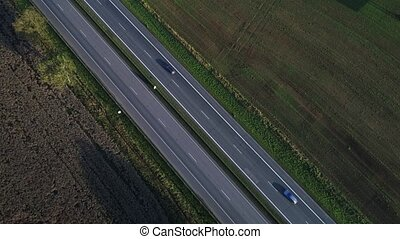 aerial view of cars going on highway at morning