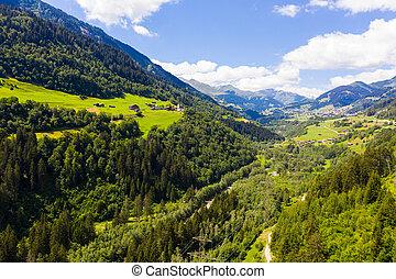 Aerial view of Cavardiras village in Swiss Alps valley