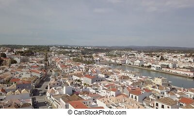 Aerial view of charming Tavira with roman bridge in sunny...