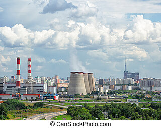 Aerial view of chimneys of a power plant, an industrial district in the North of Moscow
